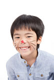 Asian boy with painted face and smiling. Cute boy with colorful painting on his face with smiling royalty free stock photography