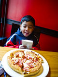 Asian boy and pizza Stock Image