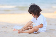 Asian boy play on beach Stock Images