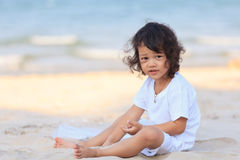 Asian boy play on beach Royalty Free Stock Photos