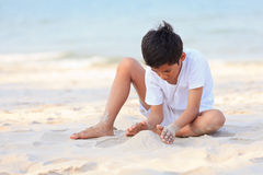 Asian boy play on beach Stock Photography
