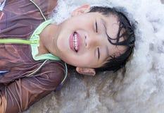 Asian boy play sea Royalty Free Stock Photography