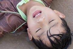 Asian boy play sea Stock Photos