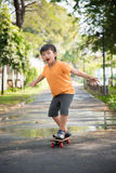 Asian boy play skateboard Royalty Free Stock Photo