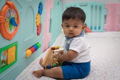 Free Asian Boy Play Toy In Room Royalty Free Stock Image - 116817296