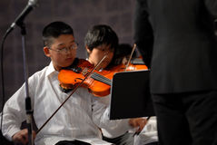 Asian boy play the violin. Unidentified Asian teenage boy of Grover Washington Jr Middle School plays the violin during the Grover Washington Spring Music stock images