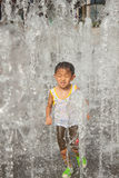 A asian boy play by water fountain Royalty Free Stock Photos