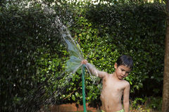 Asian boy played water. Asian young boy played water in park Stock Images