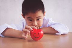 Asian boy playing as a doctor care healthy heart royalty free stock photos