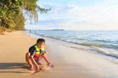 Asian boy playing on the beach Royalty Free Stock Photography