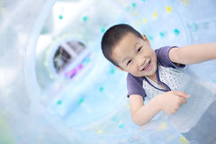 Asian boy playing in big air balloon Stock Images
