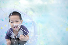 Asian boy playing in big air balloon Royalty Free Stock Photo