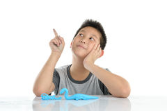 Asian boy playing blue clay on white Stock Photo