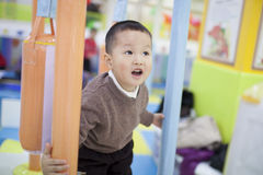 Asian boy playing in the children center Stock Photo
