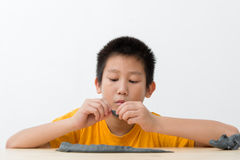 Asian boy playing clay at home. Stock Photo