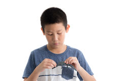 Asian boy playing clay on white background Royalty Free Stock Photos