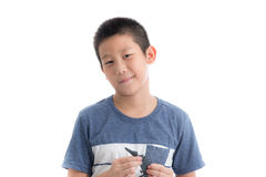 Asian boy playing clay on white background Royalty Free Stock Photo