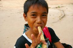 Asian boy playing flute Royalty Free Stock Photography