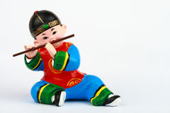 Asian boy Playing Flute Clay figure Royalty Free Stock Photo