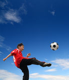 Asian boy playing football Royalty Free Stock Photo