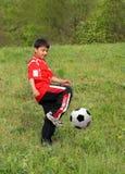 Asian boy playing football Stock Photo