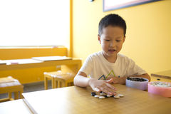 Asian boy playing the game of  I-go Royalty Free Stock Photo