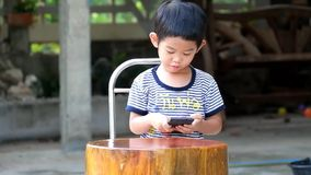 Asian boy playing games on smart phone joyfully, asian   boy celebration on winning game on smartphone. stock video