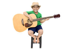 Asian boy playing guitar on isolated white background stock image