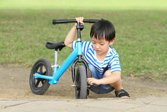 Asian boy playing his bicycle Stock Images