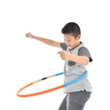Asian boy playing with the hulahoop on a white Royalty Free Stock Photo