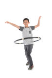 Asian boy playing with the hulahoop on a white Royalty Free Stock Image