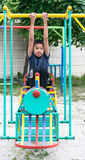 The asian boy is playing  a playground  on blurred tree backgroud village of funny. Stock Photos