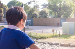 Asian boy is playing in playground in park Stock Image
