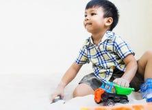 Asian boy is playing in sandbox Stock Image