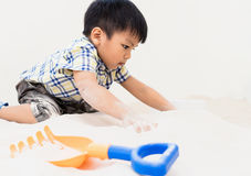 Asian Boy is playing with sandbox. In educational playground Stock Photo