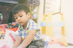 Asian Boy is playing in a sandbox Royalty Free Stock Image