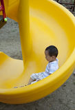 Asian boy playing the slide at playground Royalty Free Stock Photography