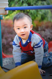 asian boy playing the sliding board Royalty Free Stock Photo