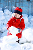Asian boy is playing snow Royalty Free Stock Photos