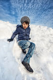 Asian boy playing in snow Royalty Free Stock Photos