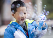 Asian boy playing soap bubble Stock Photo