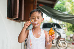 Asian boy playing with soap bubbles, Boy with Bubbles.  Stock Photo