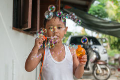 Asian boy playing with soap bubbles, Boy with Bubbles.  Stock Image