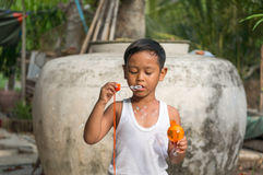 Asian boy playing with soap bubbles, Boy with Bubbles.  Stock Photography