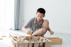 Asian boy playing a Structure from Wooden Blocks Stock Images