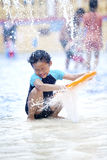 Asian boy playing  at swimming pool Stock Images
