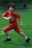Asian boy playing tag at the park Royalty Free Stock Image