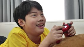 Asian boy playing video game at home .4K Slow motion. Asian boy is playing video game at home .4K Slow motion stock footage