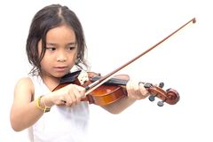 Asian boy playing violin in undershirt royalty free stock photo