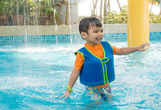 Asian boy playing in water park Stock Photo